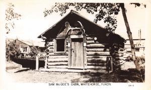 Whitehorse Yukon Canada~Sam McGee's Log Cabin~Moose Antlers~Boat in Yard~RPPC