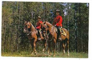Two members of the Royal Canadian Mounted Police in their striking scarlet un...