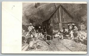 RPPC Lumberjacks Taking A Break Near the Lumber Shack~Logs & Stumps~RPPC c1910