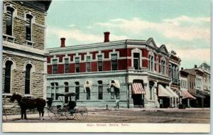 Beloit, Kansas Postcard MAIN STREET Downtown Scene Store Awnings c1910s Unused