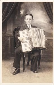 RP: TORONTO , Ontario ,Canada , 10-30s ; Boy w/accordion