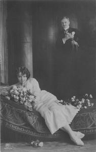 Vintage Couple, provocative woman, flowers, bed