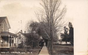 Spencer Wisconsin~Looking Down Sidewalk by Dirt Main St~RPPC 1909 Postcard