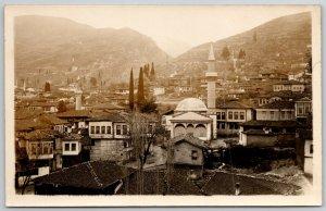 Bursa Turkey~Minarets~Tall Pine Trees~Homes on Stilts RPPC c1915 Ottoman Empire