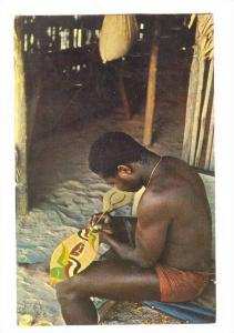 Bushnegro painting a Paddle, Suriname, PU-1964