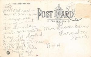 Scranton Iowa~Is a Dead Old Place~Pretty Lady Holds Pennant Flag~1912 Postcard