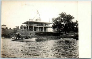 Vintage RPPC Real Photo Postcard Lake Boating Scene / House / U.S Flag c1910s