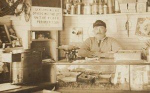 RP: EAST MACHIAS , Maine , 1911 ; Shopkeeper at counter