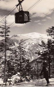 RP: Franconia Notch , New Hampshire , 1930-40s ; Skier watches aloft Tram