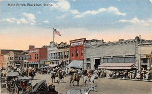 G17/ Blackfoot Idaho Postcard c1910 Main Street Parade Indians Stores