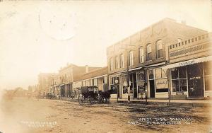 Pleasanton KS Dirt Street Horse & Wagon Store Fronts Signed RPPC Postcard