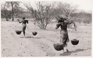 Africa Ethiopia Eritrea Cunama ethnic native girls carrying water from well rppc
