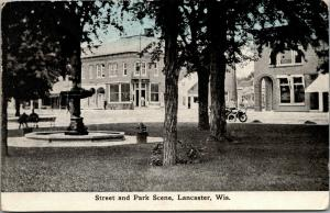 Lancaster Wisconsin~Main Street Stores~Civil War Fountain~Park Benches~c1910 PC