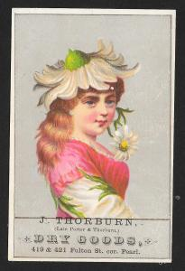 VICTORIAN TRADE CARD Thorburn Dry Goods Lady with Hat of a Daisy