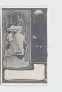 RPPC REAL PHOTO POSTCARD VOYEUR MAN PEEPING THROUGH KEYHOLE AT WOMAN AS SHE UNDR