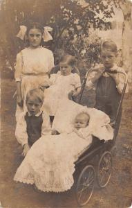 Real Photo Postcard~5 Pouty Children in Sunday Best~Baby in Lace~Carriage~c1912