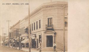 Rockwell City IA~4th Street~Bank~Basement Barber~News Stand~Music Book~1906 RPPC