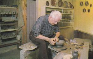 The potter turning a bowl on his wheel, Old Sturbridge Village, Sturbridge, M...