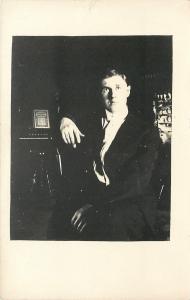 Real Photo Postcard~Man Rests Arm~Pump Organ, Sheet Music for Violin, Piano~1913
