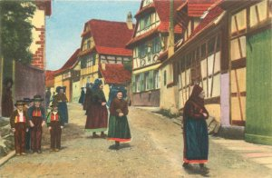 Postcard France En Alsace Return from Church ethnic types and scenes folk outfit