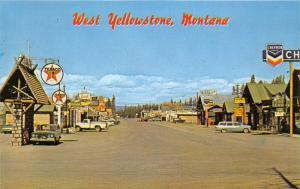 West Yellowstone Montana~Downtown Street~Chevron-Texaco-Mobil Gas~1950s Roadside