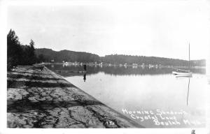 Beulah Michigan~Crystal Lake Morning Shadows~Man on Boat Dock~Sailboat~1948 RPPC