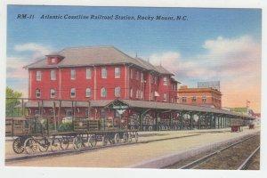 P1992, vintage postcard cargo wagons atlantic coast train station rocky mt NH