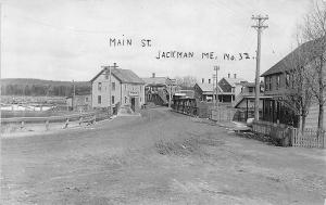 Jackman ME Dirt Street Iron Bridge Store Fronts W. A. Taylor Store RPPC Postcard