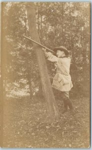 1910s RPPC Real Photo Postcard Little Boy with Rifle, Taking Aim Against Tree