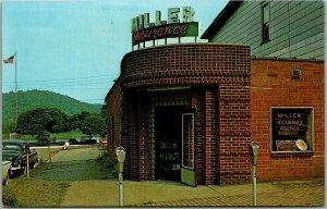Wellsville, Ohio Postcard MILLER'S INSURANCE AGENCY Street View c1950s Unused