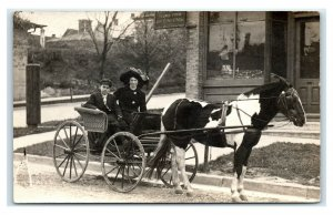 Postcard Horse Carriage,Sewer Piping & Tinning Storefront - Manistee MI? RPPC N5