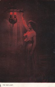 TUCK 917, 1900-10s; The Red Lamp, Rembrandesque', Woman reach for lamp