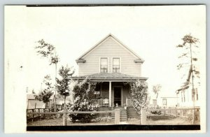 Marble MN~2-Story Home~Barbed-Wire Fence~Dog & Girl on Porch~Hammock RPPC c1910