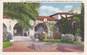AGUA CALIENTE, Mexico, 1930-1940's; Entrance To Casino, Wishing Well In Foreg...