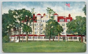 Deland Florida~Hotel College Arms~View from Across Lawn~Flag in Front~c1910