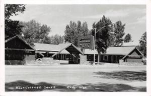 D66/ Cody Wyoming Wy Postcard Real Photo RPPC c50s Mountaineer Court Motel