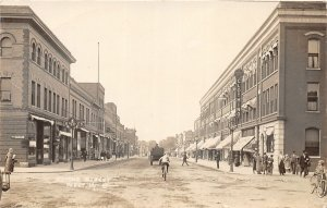 G24/ Perry Iowa RPPC Postcard c1910 Second Street Stores Bicycles