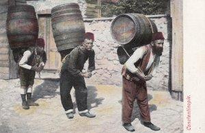 CONSTANTINOPLE , Turkey , 1900-10s ; Men Carrying barrels