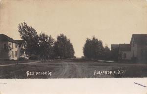Alexandria South Dakota~Homes on Wide Dirt St~Trees Bend in Wind~RPPC 1907