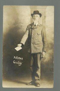 RPPC c1910 R.F.D. MAILMAN Studio Shot CHRISTMAS CARD holding LETTER Uniform USPS