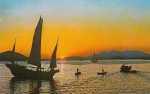 CHINA (Hong Kong) , 50-60s ; Fishing Boat under Sun Set