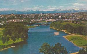 The city of Calgary is seen here with the Bow River, the Canadian Rockies, Al...