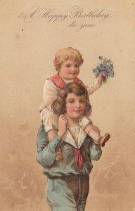 BIRTHDAY, PU-1908; Boy carrying little boy piggy-back holding bouquet of flowers