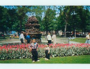 Unused 1950's BOY SMOKING A PIPE AT TULIPS IN PARK Holland Michigan MI t3991