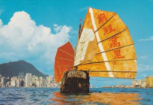 HONG KONG, China, 1950-1970's; Chinese Junk, Tourist Centre In The Background