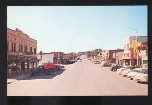 GILLETTE WYOMING 1950's CARS DOWNTOWN STREET SCENE STORES TRUCK POSTCARD