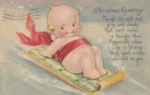 Rosie O'NEILL; CHRISTMAS ; Kewpie on sled , 1919