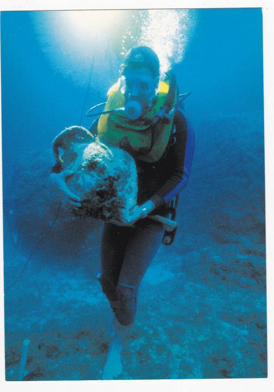 FINIKE, Turkey, 2008; Archaeologist Holding an Intact Mycenaean Stirrup Jar, Cap