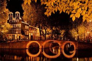 Netherlands Amsterdam Canal Scene At Night