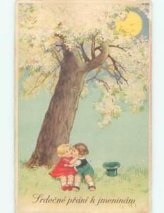 foreign c1910 EUROPEAN GIRL AND BOY KISSING UNDER FLOWERING TREE AC2017